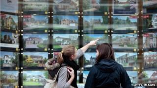 People looking at houses