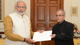 Narendra Modi (left) met President Pranab Mukherjee to claim his right to form the government