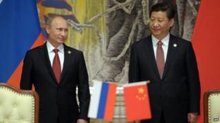 Vladimir Putin (left) and Xi Jinping