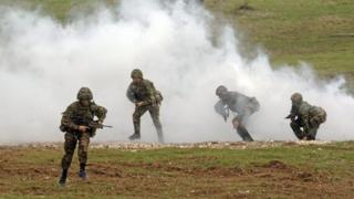 Soldiers from the British Army take part in a training exercise on Salisbury Plain, Wiltshire.