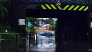 Car in flood water in Wymondham