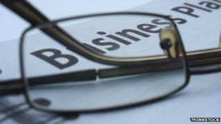 Spectacles resting on business plan