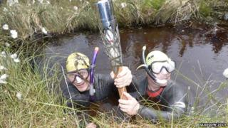 Bog snorkelers with the Baton at Peatlands Park, Dungannon