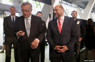 Jean-Claude Juncker (left) and Martin Schulz attend a debate in Hamburg, Germany, 20 May