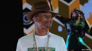 Pharrell Williams smiles on stage