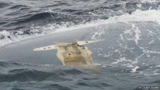 The overturned hull of the Cheeki Rafiki