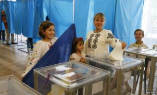 A woman casts her ballot in Kiev