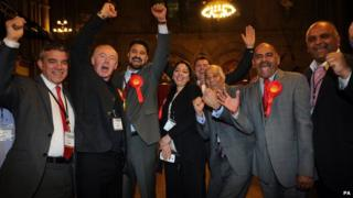 Labour party members celebrate in Manchester