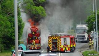 Fairground ride on fire on the A487 at griffith's Crossing in Gwynedd