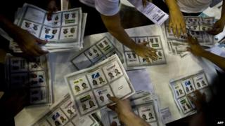 Electoral personnel count votes at a polling station after presidential elections on May 25, 2014, in Medellin, Antioquia department, Colombia