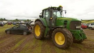 A tractor towed cars out of the car park