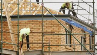 Builders working on a house