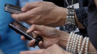 Mobile phones in hands