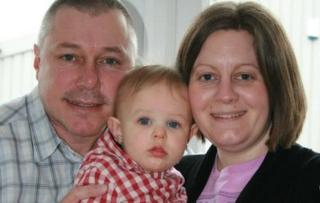 Stuart and Lisa Pashley, with their son
