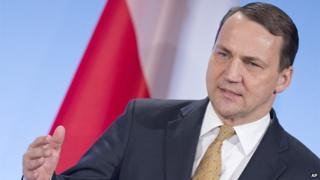 Polish Foreign Minister Radoslaw Sikorski gestures during a press conference after a meeting with his German and French counterpart - the so-called Weimar Triangle - in the city castle in Weimar, Germany, Tuesday, April 1