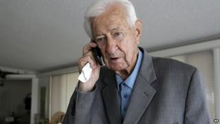 Representative Ralph Hall speaks on a cell phone on 27 May, 2014.