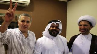 Nabeel Rajab (left) celebrates his release from prison with Osama Tamim (centre) and Sheikh Ali Salman (right) in Bani Jamra, Bahrain (24 May 2014)