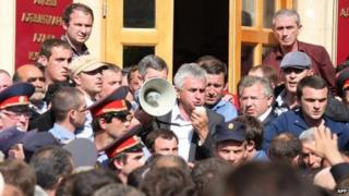 Opposition leader Raul Khadzhimba addresses protesters in front of the presidential office in Sukhumi, Abkhazia, 27 May