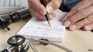 Doctor writing out prescription generic