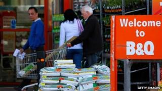 Customers exit a B&Q home improvement store,