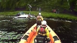 Loch Ness RNLI and grounded cruiser