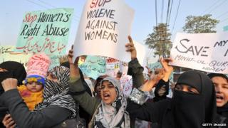 Supporters of Tehrik-e-Minhaj ul Quran, an Islamic Organisation protest against 'honour killings' of women in Lahore on November 21, 2008. Human rights lawyer Zia Awan said that more than 62,000 cases of women abused in Pakistan since the year 2000 and 159 women died in honour killings in the year to September 30