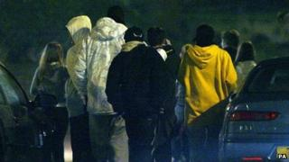 Group of young people gathered at night