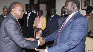 Kenya's President Uhuru Kenyatta (L) receives South Sudan's rebel leader Riek Machar at State House in Nairobi, Kenya - 29 May 2014