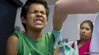 A California child receives an immunisation shot.