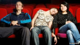 People sleeping in theatre