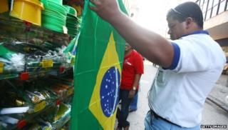 Man holding Brazilian flag