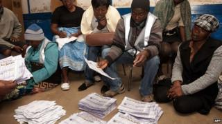 Malawian Electoral Commission workers count voted ballots on May 20, 2014 in Blantyre, Malawi