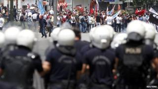 Protesters are confronted by police during a demonstration at Kizilay square in central Ankara on 16 June , 2013.