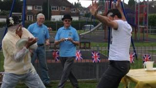 BBC Radio Kent reporter Phil Harrison (right) takes part in a custard pie contest with organisers of the World Championship in Coxheath