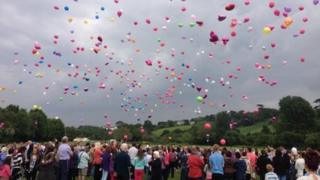 Hundreds of balloons were released
