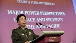 "Deputy Chief of the General Staff of the People""s Liberation Army (PLA) Wang Guanzhong speaks during the fourth plenary session at the 13th International Institute for Strategic Studies (IISS) Shangri-La Dialogue (SLD) in Singapore on June 1, 2014."