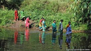 Women fording the river in Edamalakudi