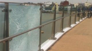 A broken glass panel on the Adur Ferry Bridge