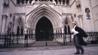 Lawyer outside Royal Courts of Justice