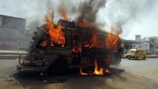 A bus burns after being set on fire by protesters condemning the arrest in London of Altaf Hussain, who heads the Muttahida Qaumi Movement, or MQM, one of Pakistan's major political parties, in Karachi, Pakistan, Tuesday, June 3, 2014