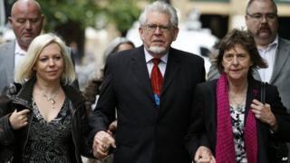 Rolf Harris (c) with daughter Bindi (l)
