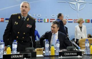 "Acting Ukrainian Defence Minister Mykhailo Koval (L) and North Atlantic Treaty Organization (NATO) Secretary General Anders Fogh Rasmussen arrive for a defence ministers"" meeting at the NATO headquarters in Brussels on June 3"