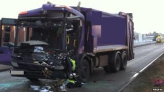The damaged rubbish truck