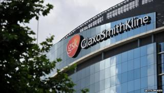 GSK building with logo and tree in front