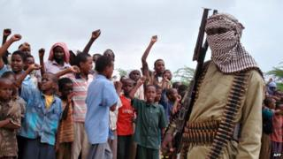 Somali boys chant as they watch hard-line Islamist fighters from al-Shabab parade during a rally in the streets of Mogadishu, Somalia - 30 October 2009