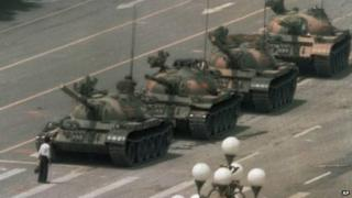 A man tries to block tanks near Tiananmen Square in Beijing. Photo: 5 June 2014