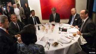 US Secretary of State John Kerry (L) and President Barack Obama (2nd L) sit as they dine with French Foreign Minister Laurent Fabius (2nd R) and President Francois Hollande (R) in Paris on 5 June 2014.