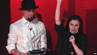 Sister Cristina Scuccia receives the winner's trophy. 6 June 2014