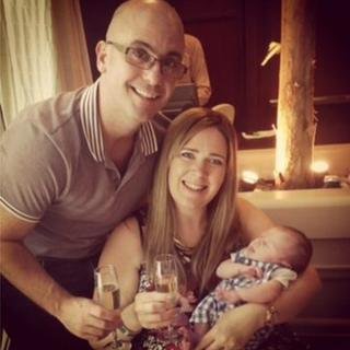 Phil and Claire White in Qatar with baby Dylan