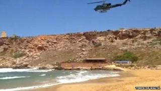 Army helicopter at beach